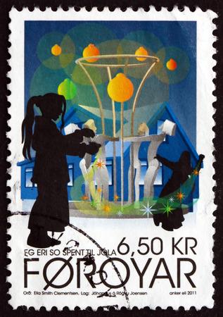 carols: FAROE ISLANDS - CIRCA 2011: a stamp printed in Faroe Islands shows Christmas Carols, circa 2011