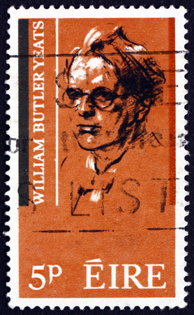 dramatist: IRELAND - CIRCA 1965: a stamp printed in Ireland shows William Butler Yeats, Irish Poet and Dramatist, circa 1965