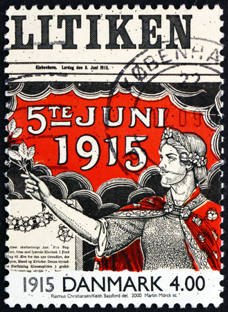 suffrage: DENMARK - CIRCA 2000: a stamp printed in Denmark shows Allegory of Women Suffrage on Front Page of Newspaper, 1915, circa 2000 Editorial