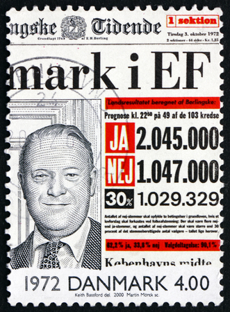 european community: DENMARK - CIRCA 2000: a stamp printed in Denmark shows Entry of Denmark into European Community on Front Page of Newspaper, 1972, circa 2000 Editorial