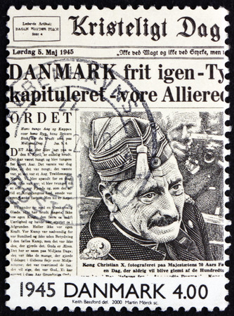 front page: DENMARK - CIRCA 2000: a stamp printed in Denmark shows Liberation of Denmark on Front Page of Newspaper, 1945, circa 2000