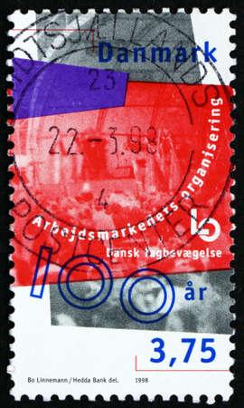 confederation: DENMARK - CIRCA 1998: a stamp printed in Denmark dedicated to Danish Confederation of Trade Unions, Centenary, circa 2000 Editorial