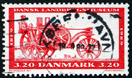 centenary: DENMARK - CIRCA 1989: a stamp printed in Denmark shows Tractor, 1889, Centenary of the Agricultural Museum, circa 1989 Editorial