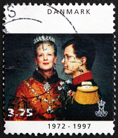 coronation: DENMARK - CIRCA 1997: a stamp printed in Denmark shows Queen Margrethe II with Crown Prince Frederik, 25th Anniversary of Coronation, circa 1997 Editorial