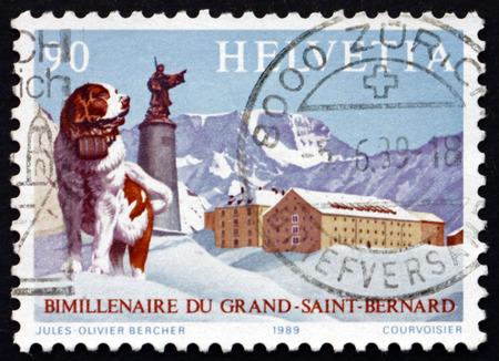 st bernard: SWITZERLAND - CIRCA 1989: a stamp printed in Switzerland shows St. Bernard Dog, Statue of Saint and Hospice on Summit, Great St. Bernard Pass Bimillennium, circa 1989