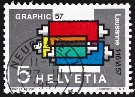 printing machine: SWITZERLAND - CIRCA 1957: a stamp printed in Switzerland shows Inking Device, Printing Machine, International Exhibition for Graphic Arts, Lausanne, circa 1957