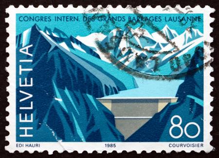 dams: SWITZERLAND - CIRCA 1985: a stamp printed in Switzerland shows Grande Dizence Dam, Canton Valais, International Congress on Large Dams, Lausanne, circa 1985