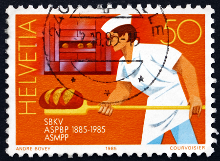 centenary: SWITZERLAND - CIRCA 1985: a stamp printed in the Switzerland shows Baker, Centenary of Swiss Master Bakers and Confectioners Federation, circa 1985 Editorial