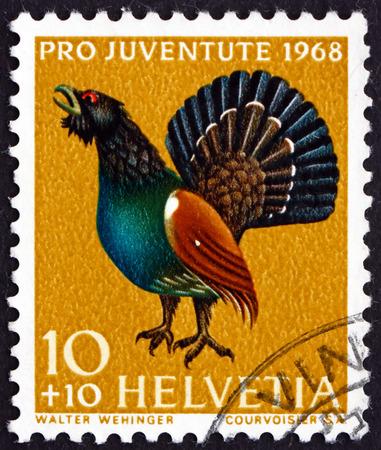 helvetia: SWITZERLAND - CIRCA 1968: a stamp printed in the Switzerland shows Capercaillie, Tetrao Urogallus, Bird, circa 1968 Editorial