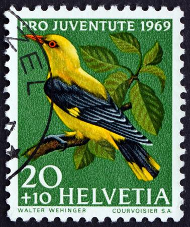 helvetia: SWITZERLAND - CIRCA 1969: a stamp printed in the Switzerland shows Golden Oriole, Oriolus Oriolus, Passerine Bird, circa 1969