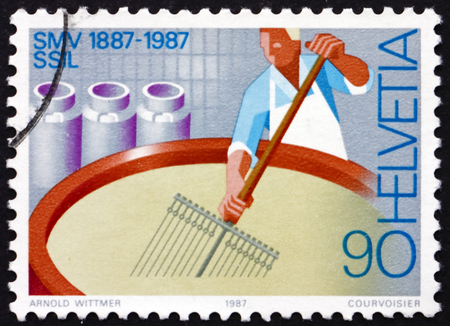 centenary: SWITZERLAND - CIRCA 1987: a stamp printed in the Switzerland shows Cheesemaker, Swiss Diary Association, Centenary, circa 1987