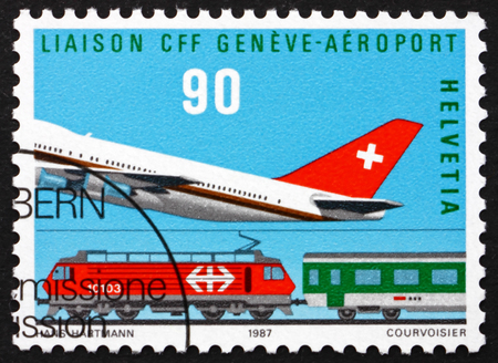 helvetia: SWITZERLAND - CIRCA 1987: a stamp printed in the Switzerland shows Plane and Train, Cointrin Airport-Geneva, Rail Link Opening, circa 1987 Editorial