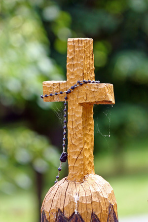 wood pillars: Wooden cross carved on the pillar in the park