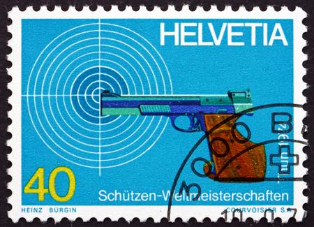 marksmanship: SWITZERLAND - CIRCA 1974: a stamp printed in the Switzerland shows Target and Pistol, World Marksmanship Championships, Thun and Bern, circa 1974