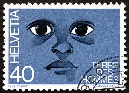 SWITZERLAND - CIRCA 1973: a stamp printed in the Switzerland dedicated to Terre des Hommes, Childrens Aid Program, circa 1973