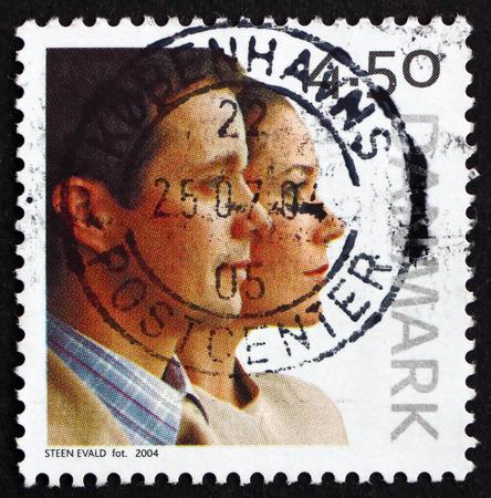 prince of denmark: DENMARK - CIRCA 2004: a stamp printed in Denmark dedicated to Wedding of Crown Prince Frederik and Mary Donaldson, circa 2004 Editorial