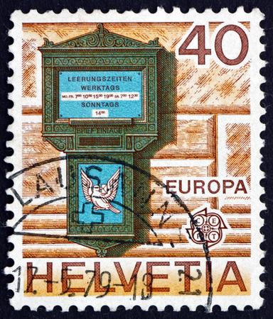 letter box: SWITZERLAND - CIRCA 1979: a stamp printed in the Switzerland shows Letter Box, 1845, Spalentor, Basel, circa 1979