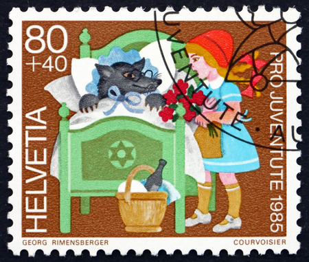 little red riding hood: SWITZERLAND - CIRCA 1985: a stamp printed in the Switzerland shows Little Red Riding Hood, Fairy Tale by Jakob and Wilhelm Grimm, circa 1985