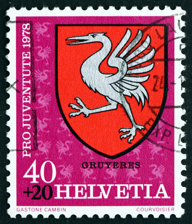 communal: SWITZERLAND - CIRCA 1978: a stamp printed in the Switzerland shows Gruyeres, Communal Arms, circa 1978