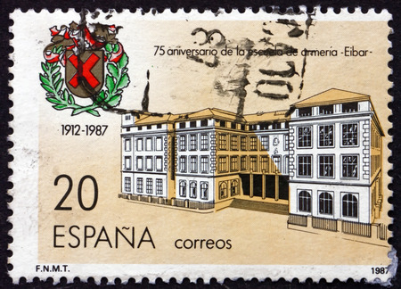 weaponry: SPAIN - CIRCA 1987: a stamp printed in the Spain shows Elbar Weaponry School, 75th Anniversary, circa 1987