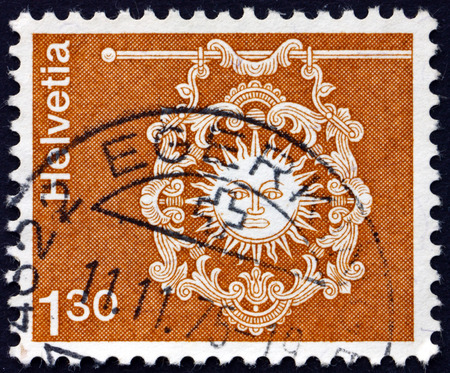 toggenburg: SWITZERLAND - CIRCA 1973: a stamp printed in the Switzerland shows Sign of Inn Zur Sonne, Toggenburg, circa 1973