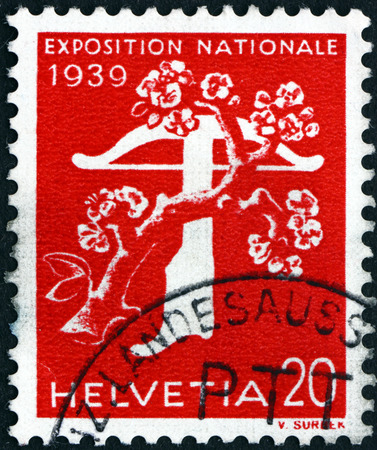crossbow: SWITZERLAND - CIRCA 1939: a stamp printed in the Switzerland shows Tree and Crossbow, National Exposition of 1939, circa 1939 Editorial