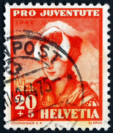glarus: SWITZERLAND - CIRCA 1942: a stamp printed in the Switzerland shows Girl of Glarus, circa 1942