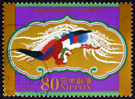 accession: JAPAN - CIRCA 2009: a stamp printed in the Japan shows Takamikura Hamayuka Houou, 20th Anniversary Akihitos Accession to Throne, circa 2009