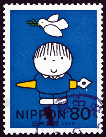 letter writing: JAPAN - CIRCA 1998: a stamp printed in the Japan shows Child with Ink Pen, Dove Overhead, Letter Writing Day, circa 1998
