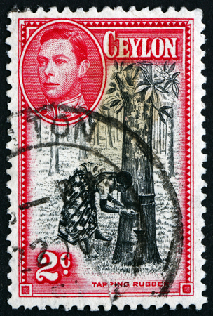 arbol de problemas: SRI LANKA - CIRCA 1938: a stamp printed in Sri Lanka shows Tapping Rubber Tree, circa 1938