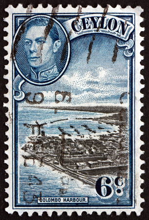 vi: SRI LANKA - CIRCA 1938: a stamp printed in Sri Lanka shows View of Colombo Harbour and Portrait of King George VI, circa 1938