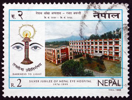 eye service: NEPAL - CIRCA 1999: a stamp printed in the Nepal shows Nepal Eye Hospital, 25th Anniversary, circa 1999 Editorial