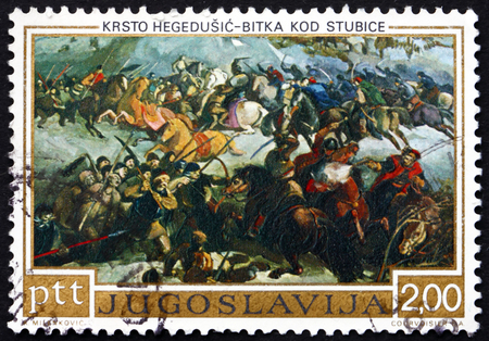 rebellion: YUGOSLAVIA - CIRCA 1973: a stamp printed in the Yugoslavia shows Battle of Stubica, Painting by Krsto Hegedusic, Croatian-Slovenian Rebellion, 400th Anniversary, circa 1973 Editorial