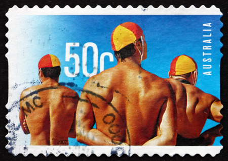 life saving: AUSTRALIA - CIRCA 2007: a stamp printed in the Australia shows Male Lifeguards, Surf Life Saving Australia, Centenary, circa 2007 Editorial