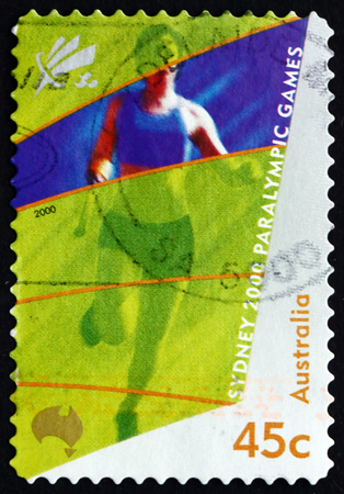 runing: AUSTRALIA - CIRCA 2000: a stamp printed in the Australia shows Amputee Runing, 2000 Paralympics, Sydney, circa 2000