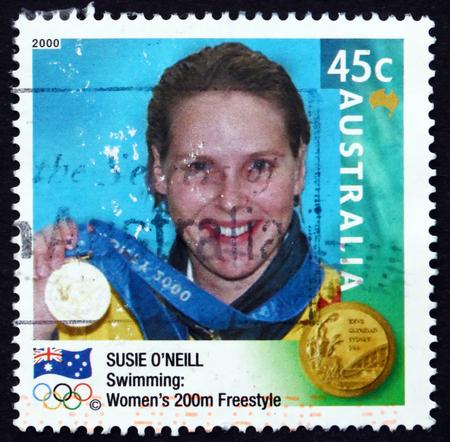 medalist: AUSTRALIA - CIRCA 2000: a stamp printed in Australia shows Susie ONeil, Womens 200m Freestyle Winner, Australian Gold Medalist at 2000 Olympics, circa 2000 Editorial