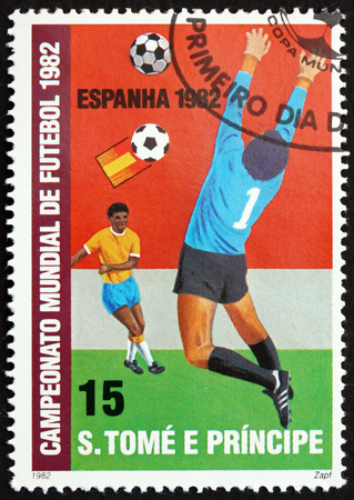 goalie: SAO TOME AND PRINCIPE - CIRCA 1982: a stamp printed in Sao Tome and Principe shows Goalie Catching Ball from Emblem in Front of Goal, circa 1982 Editorial