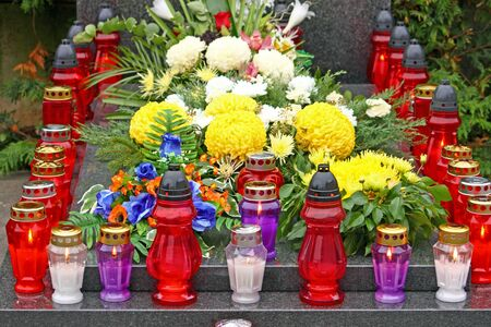 votive: Flowers and votive candles which glows on the grave, lantern