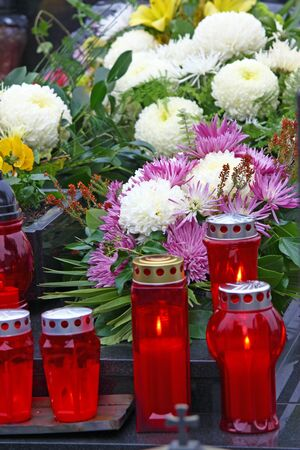 votive candle: Flowers and votive candle which glows on the grave, lantern