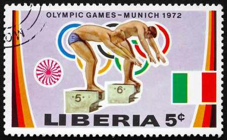 olympic games: LIBERIA - CIRCA 1972: a stamp printed in Liberia shows Swimmers at Start, 20th Olympic Games, Munich, circa 1972 Editorial