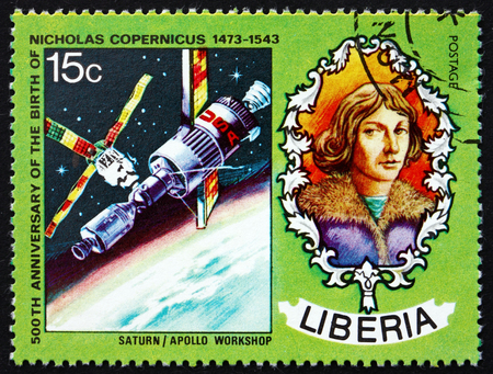 LIBERIA - CIRCA 1973: a stamp printed in Liberia shows Nicolaus Copernicus, Polish Astronomer, Saturn and Apollo Spacecraft, circa 1973 Editorial