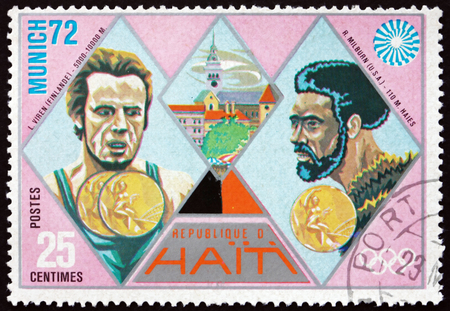 the olympic games: HAITI - CIRCA 1972: a stamp printed in Haiti shows Viren and Milburn, Gold Medal Winners, 1972 Summer Olympic Games, Munich, circa 1972
