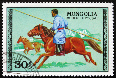 mongolia horse: MONGOLIA - CIRCA 1977: a stamp printed in Mongolia shows Hunter on Horseback, circa 1977