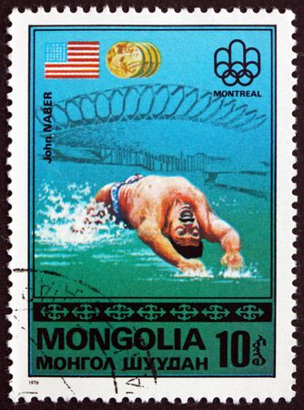the olympic games: MONGOLIA - CIRCA 1976: a stamp printed in Mongolia shows John Naber, US Flag, Gold Medal Winner, 21st Olympic Games, Montreal, circa 1976