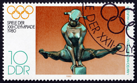GERMANY - CIRCA 1980: a stamp printed in Germany shows On the Bars, by Erich Wurzer, 22nd Summer Olympic Games, Moscow, circa 1980