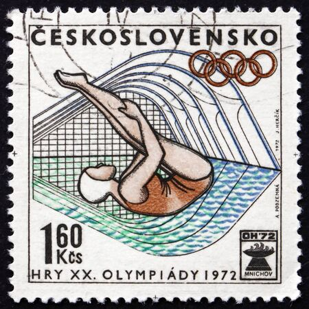 the olympic games: CZECHOSLOVAKIA - CIRCA 1972: a stamp printed in Czechoslovakia shows Diving, 20th Olympic Games, Munich, circa 1972