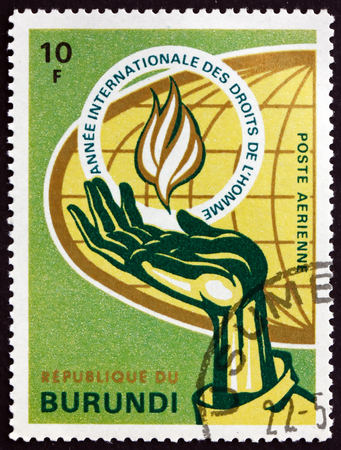 BURUNDI - CIRCA 1969: a stamp printed in Burundi shows Human Rights Flame, Hand and Globe, International Human Rights Year 1968, circa 1969 Editorial