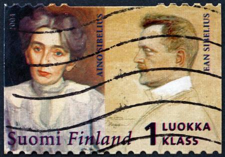 sibelius: FINLAND - CIRCA 2004: a stamp printed in Finland shows Jean Sibelius and His Wife Aino, circa 2004