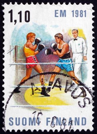 boxing match: FINLAND - CIRCA 1980: a stamp printed in Finland shows Boxing Match, European Boxing Championships, Tampere, circa 1980