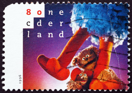 pino: NETHERLANDS - CIRCA 1996: a stamp printed in Netherlands shows Pino, Ieiemienie and Tommie, Sesame Street in Netherlands, 20th Anniversary, circa 1996